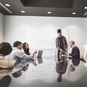 BlenderBottle employees collaborating in a meeting