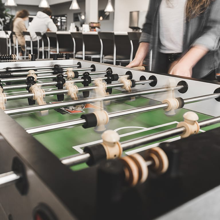 BlenderBottle employees playing foosball